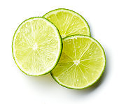 Heap of lime slices isolated on white, from above
