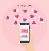 Valentine's day illustration. Send or receive love sms, letter, email with mobile phone. Human hand hold cellphone isolated on  background