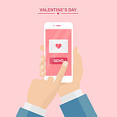 Valentine's day illustration. Send or receive love sms, letter, email with mobile phone. Human hand hold cellphone isolated on pink background. Envelope with red heart