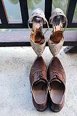 Wedding concept background .high heels and men's shoes on wooden background.Lovers' shoes.Wedding