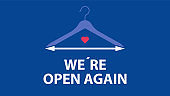 WE ARE OPEN AGAIN and Clothes hanger.
