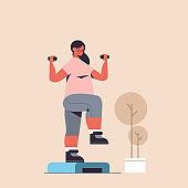 sportswoman doing exercises with dumbbells on platform girl having workout cardio fitness training