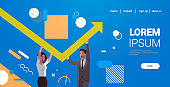 businesspeople couple rising up red growing arrow teamwork financial growth concept business people correcting direction of arrow horizontal portrait copy space
