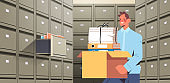 businessman holding cardboard box with documents in filing wall cabinet with open drawer data archive storage
