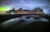 Vestrahorn mountain with Aurora borealis and startrails, Stokksnes, Iceland