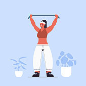 sportswoman doing exercises with resistance band girl having workout cardio fitness training healthy lifestyle