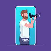 travel blogger using digital camera man photographer taking photo blogging shooting vlog concept portrait smartphone screen mobile app
