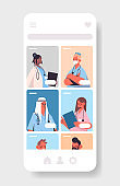 mix race doctors in mobile medical application online consultation healthcare medicine concept