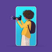 travel blogger using digital camera woman photographer taking photo blogging shooting vlog concept portrait smartphone screen mobile app