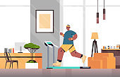 man running on treadmill at home guy having workout cardio fitness training healthy lifestyle sport