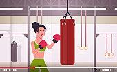 woman blogger hitting huge punching bag sportswoman boxer vlogger recording online video for blog healthy lifestyle live streaming concept modern boxing studio interior horizontal portrait