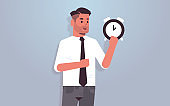 businessman holding clock time management deadline concept business man with alarm clock horizontal portrait