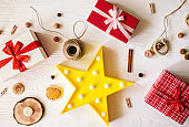 Festive gift boxes on wooden white background.