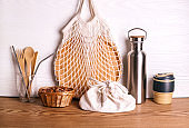 Eco set with bamboo cutlery, plate, coffee mug, water bottle and eco bag.