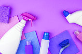 House cleaning products are on purple background.