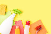House cleaning products are on yellow background.