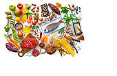 Varied food carbohydrates protein vegetables fruits dairy legumes on white