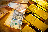 Gold bars and fiat money Dollar note and Euro financial concept