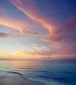 Sunset on the beach ocean sea with horizon on water soft colorful