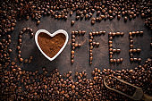 Coffee spelling word made of coffee beans and heart shape