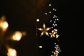 Christmas lights on dark background. Star shaped