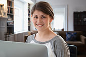 teenager girl back having online classes