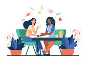Female friends talking over cup of tea