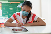 teenager girl back to school wearing mask covid 19