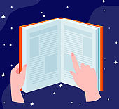 Human hands holding open book