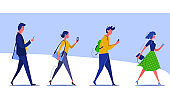 Group of walking people checking smartphones