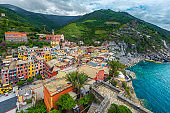 Vernazza with colorful houses and rocky coastline, Cinque Terre, Italy