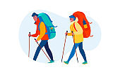 Couple with backpacks practicing trekking