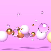 Abstract composition with golden, transparent, yellow and white spheres flying in the air on pink background. Colorful glossy bubbles. Futuristic background. 3D render.