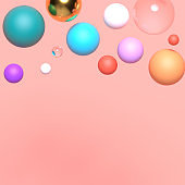 Abstract composition with golden, transparent, blue, pink, purple, and yellow plastic spheres. Colorful glossy bubbles. Futuristic background. 3D render.