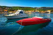 Mediterranean cityscape and harbor with motorboats, Jelsa, Hvar island, Croatia