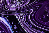 Fluid art texture. Abstract backdrop with mixing paint effect. Liquid acrylic picture with beautiful mixed paints. Can be used for interior poster. Purple, white and black overflowing colors.