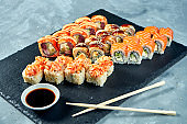 Set of traditional Japanese sushi - California and philadelphia rolls with eel, salmon and tuna. Close up
