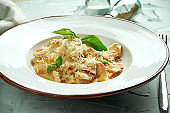 Italian fettuccini pasta with chicken, bacon and cheese in a white plate