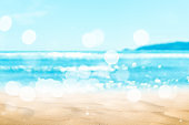 Copy space blur tropical beach with bokeh sun light wave on blue sky and white cloud abstract background.