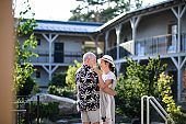 Senior couple dancing outdoors on holiday, having fun.