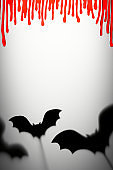 Halloween Decoration. Terrifying Shadow Puppets. Shadows bats and blood drops on the gray background.