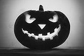 Happy Halloween. Creepy pumpkin Jack-o-lantern in smoke.