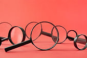 Magnifying Glasses on Red Background