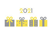 Christmas presents in trendy yellow and gray colors.