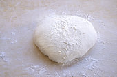 pizza dough on a pastry board