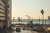 Crowds of people walking on the promenade in Tel Aviv, Israel