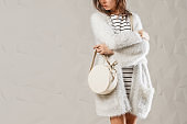 Stylish fashionable woman with white round bag