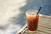 selective focus Long black coffee mixed with Lychee on nature background. iced drink menu of summer drink for relaxing day.