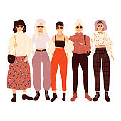 Group of adorable women dressed in trendy clothes isolated on white background. Flat cartoon vector illustration.