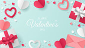 Valentine's day greeting card with heart shape, envelope, and gift box. Paper cut style.